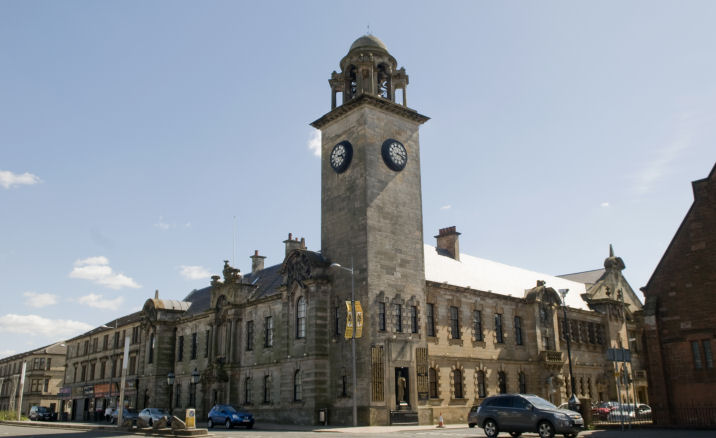Photo of the Clydebank Town Hall with blue sky behind it
