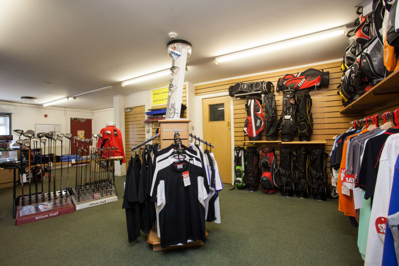 image of Inside the Pro Shop - polo shirts and putters