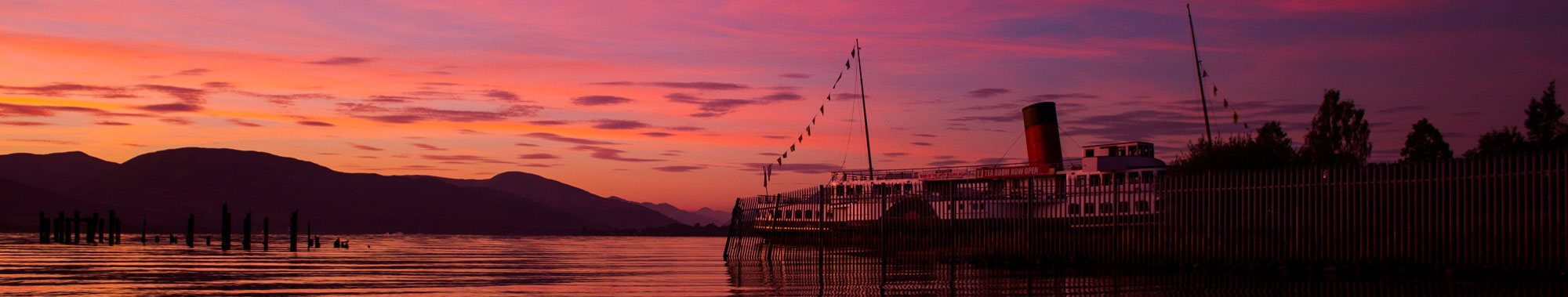 Photo of the Maid of the Loch with a purple sky