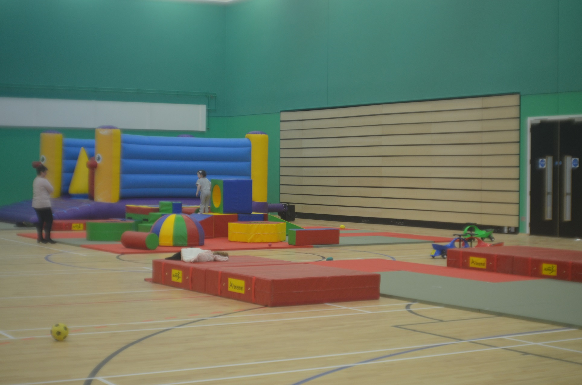 Sports hall with some soft play equipment in it 21
