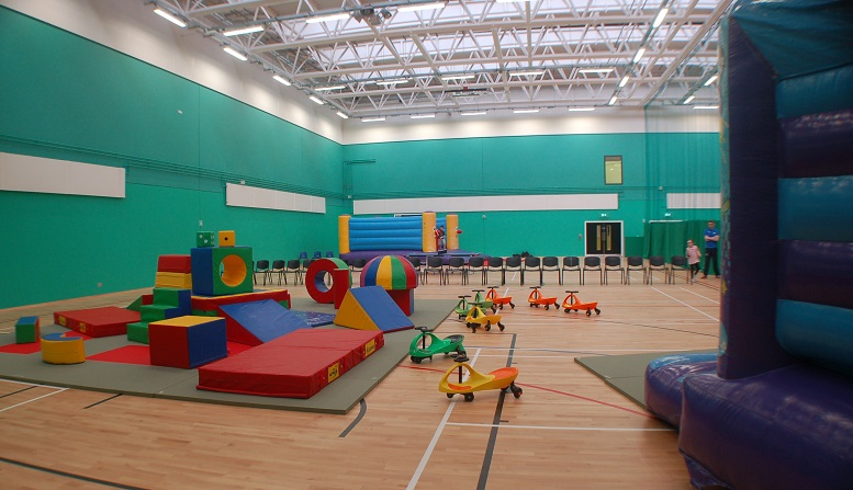 Sports hall set up for family night with some soft play 33