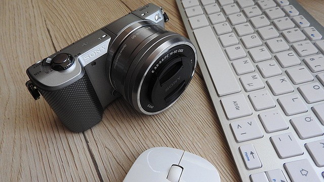 Camera beside a mouse and keyboard